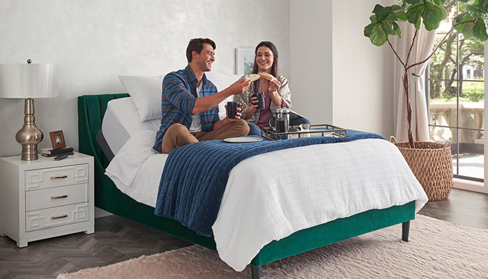 Couple Eating on Bed
